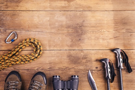Equipment for hiking on a wooden floor background Reklamní fotografie