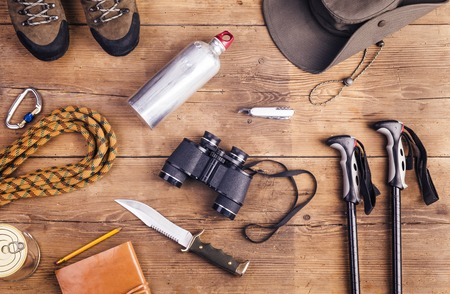 sports equipment: Equipment for hiking on a wooden floor background Stock Photo
