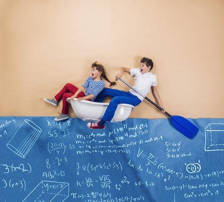 math: Joyful schoolkids as sailors on the sea. Studio shot on a beige .