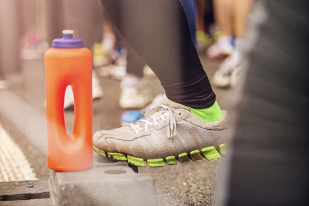finish line: Detail of the legs of runners at the start of a marathon race Stock Photo
