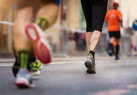 man legs: Unrecognizable young runners at the city race