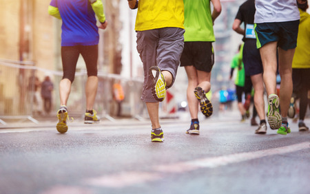 Unrecognizable young runners at the city race photo
