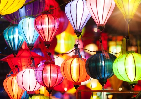 Traditional colorful silk lanterns at market street in Vietnam. Stock Photo