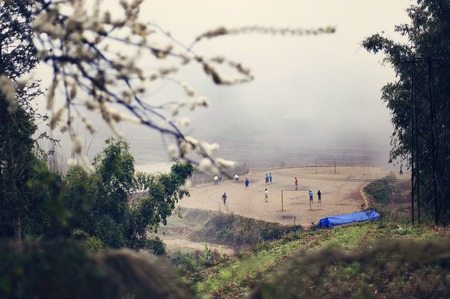 Vietnamese children playing at the playground among terraced rice fields of Sapa. photo