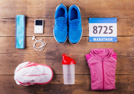 Various running stuff lined up on a wooden floor background