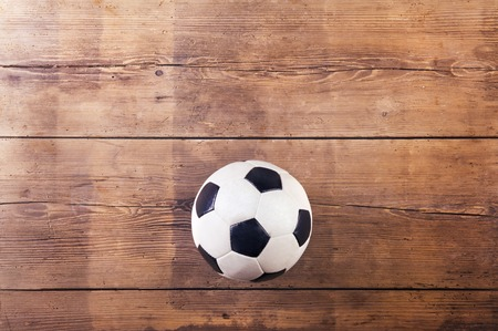 laid: Soccer ball laid on a wooden floor background Stock Photo
