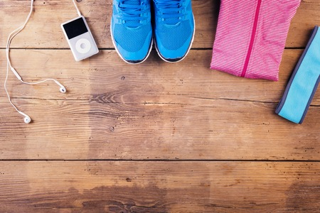 lined up: Various running stuff lined up on a wooden floor background