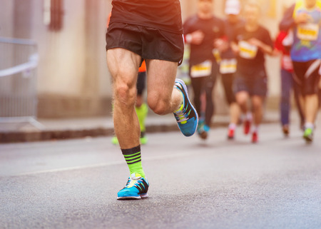 sports shoe: Unrecognizable young runners at the city race