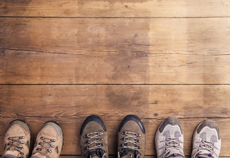 wooden shoes: Hiking shoes laid on a wooden floor background