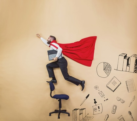 successful businessman: Manager with coat of superman. Superhero in studio.