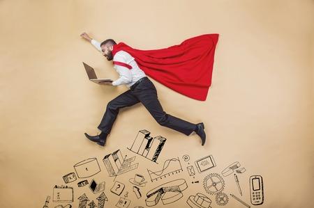 Manager with coat of superman. Superhero in studio. photo