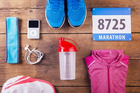 Various running stuff lined up on a wooden floor background photo