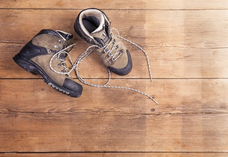 hiking: Hiking shoes laid on a wooden floor background