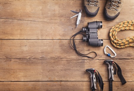 equipment: Equipment for hiking on a wooden floor background Stock Photo