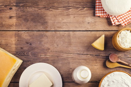 laid: Variety of dairy products laid on a wooden table background Stock Photo