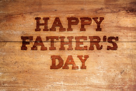 clear day: Happy fathers day sign on wooden boards background.