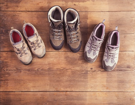 laid: Hiking shoes laid on a wooden floor background