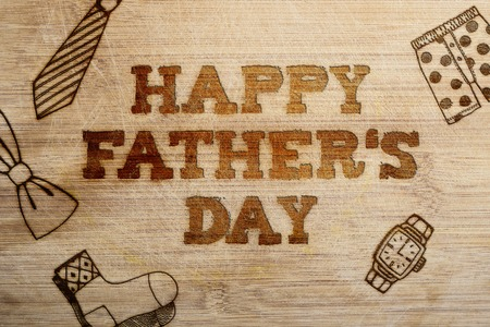 father's day: Happy fathers day sign on wooden boards background.