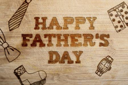 lazo regalo: Muestra feliz del día de padres sobre tablas de madera de fondo.