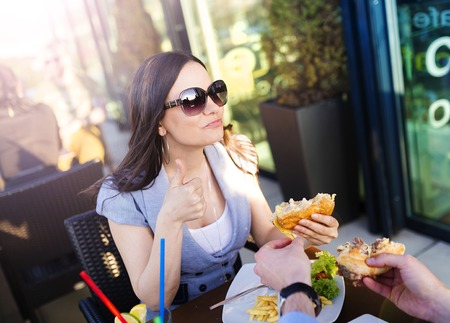Beautiful young couple enjoying a meal together Stock Photo