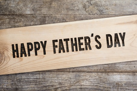happy holidays text: Happy fathers day sign on wooden boards background.