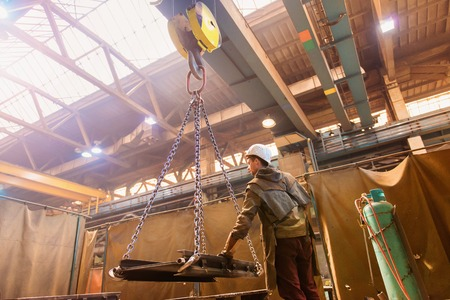 hoist: Welder in factory