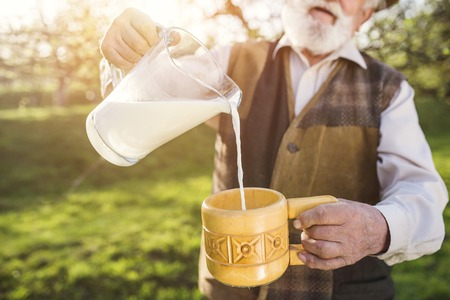 milk jugs: Senior man Stock Photo
