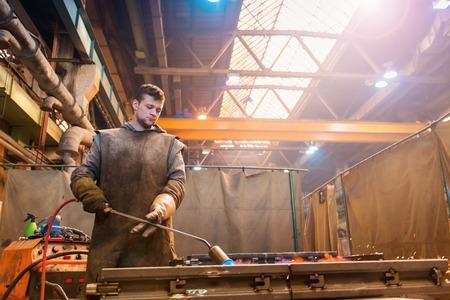 steel building: Young welder