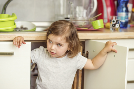 hide and seek: Little girl Stock Photo