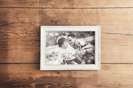 fun day: Picture frame with family photo laid on a wooden .