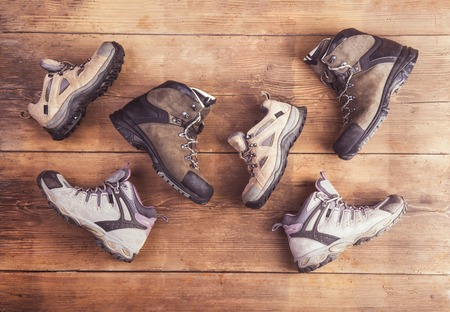 hiking shoes: Hiking shoes laid on a wooden floor  Stock Photo