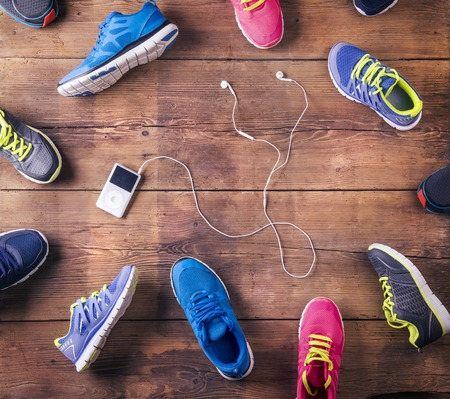 mp3 player: Sports shoes and mp3 player Stock Photo