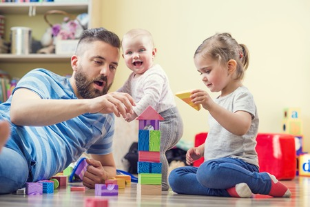 baby playing toy: Father and daughters Stock Photo