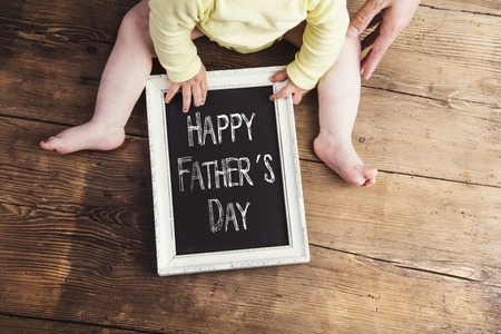 happy baby: Little baby with Happy fathers day sign on wooden  Stock Photo