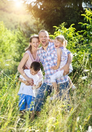 happy family nature: Happy young family spending time together outside in green nature. Stock Photo