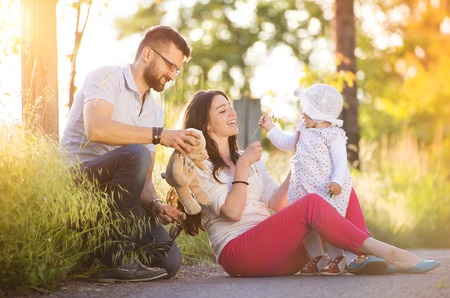 happy family nature: Happy young family having fun outside in spring nature Stock Photo