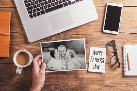 son's: Fathers day composition - office desk. Studio shot on wooden background. Stock Photo