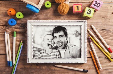 photo backgrounds: Fathers day composition - toys on floor. Studio shot on wooden background.