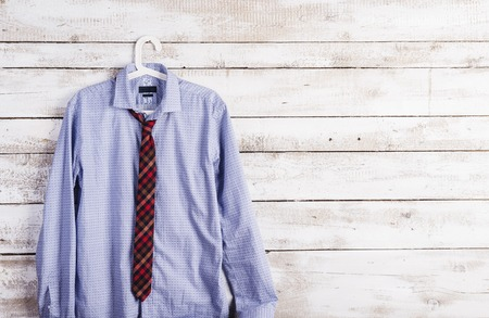 Fathers day composition of shirt and tie hang on wooden wall background. photo