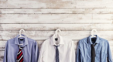 Fathers day composition of shirts and ties hang on wooden wall background. photo
