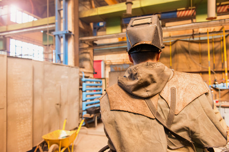 protective workwear: Young man in a welding factory in protective workwear
