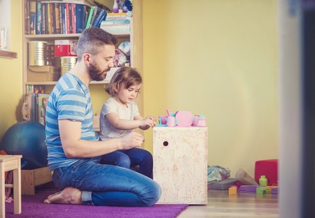 Young hipster father playing with his daughter Stock Photo