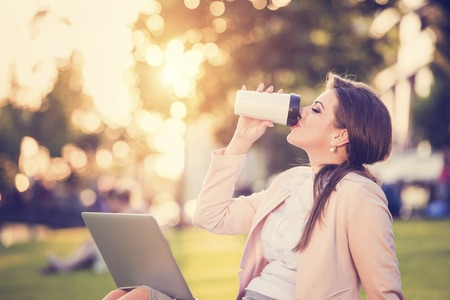 Attractive young business woman having a lunch break photo