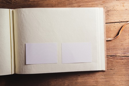 photoalbum: Photoalbum with an empty space for photos. Studio shot on wooden background. Stock Photo