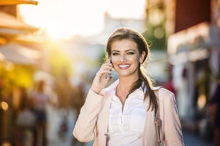 phone professional: Beautiful woman Stock Photo