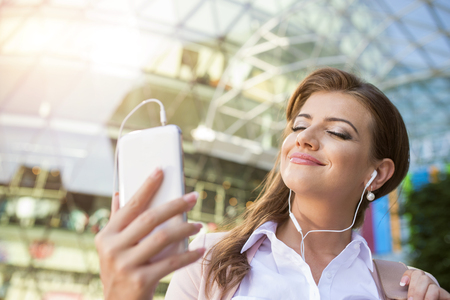 woman on phone: Woman with phone Stock Photo