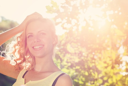 glamour girl: Attractive young woman outside in summer nature