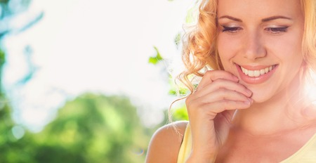 smile close up: Attractive young woman outside in summer nature