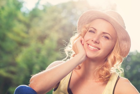 woman face close up: Attractive young woman outside in summer nature