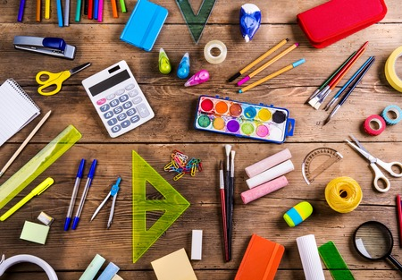 crayon  scissors: Desk with stationary and with Back to school sign. Studio shot on wooden background. Stock Photo